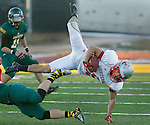 SPEARFISH, SD - NOVEMBER 23, 2013:  Anthony Apodaca #29 of Western State Colorado University gets tripped up by a Black Hills State defender during their game Saturday at Lyle Hare Stadium in Spearfish, S.D. Black Hills State won 50-48 in triple overtime.  (Photo by Dick Carlson/Inertia)