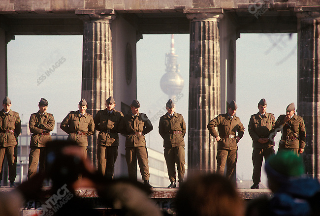 East German police keep watch during the opening of the Berlin Wall. West Berlin, Germany, November 1989