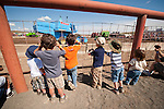Small children watch the action during the 24th Lind Combine Destruction Derby, grain truck races, parade. Sponsored by the Lind, Wash., Lions Club.