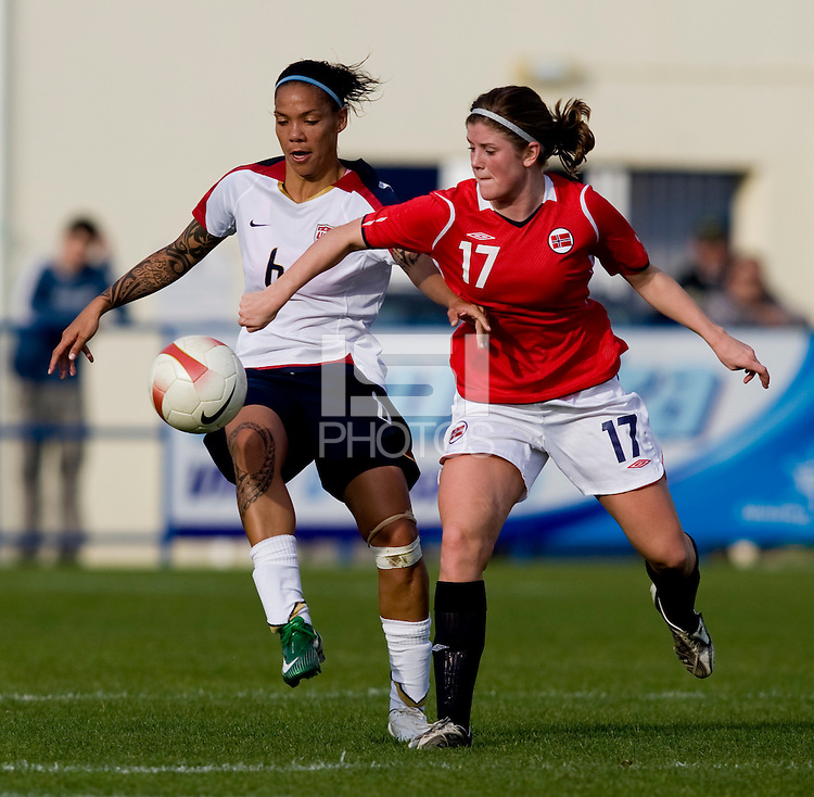 USWNT forward (6) Natasha Kai fights for the ball with Norwegian midfielder (17) Maren Mjelde during the last group stage game in the Algarve Cup.  The USWNT defeated Norway, 1-0, in Ferreiras, Portugal. Photo by Brad Smith/ isiphotos.com