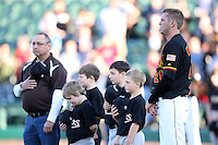 Rochester Red Wings Pitcher Ryan Mullins stands with little leaguers for the national anthem during a game vs. the Louisville Bats Friday, May 14, 2010 at Frontier Field in Rochester, New York.   Rochester defeated Louisville by the score of 13-4.  Photo By Mike Janes/Four Seam Images
