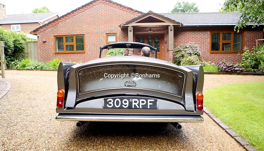 BNPS.co.uk (01202 558833)<br /> Pic: Bonhams/BNPS<br /> <br /> The whole roof moves in one piece into its stored position.<br /> <br /> Ahead of its time - revolutionary British invention from the swinging sixties that first put the wind in your hair.<br /> <br /> This unique Daimler sports car from 1963 features the worlds first electric roof - that enabled motorists to open up the roof even when travelling at 100 mph.<br /> <br /> The 1960 Daimler SP250 is a one-off prototype and was 30 years ahead of its time - the first car to have a working retractable roof after more than 5,000 man hours and £30,000 were spent on it.<br /> <br /> It has been in the same family for 56 years since it was bought new and is now being sold at Bonhams Goodwood Revival on September 10 with a £70,000 estimate.