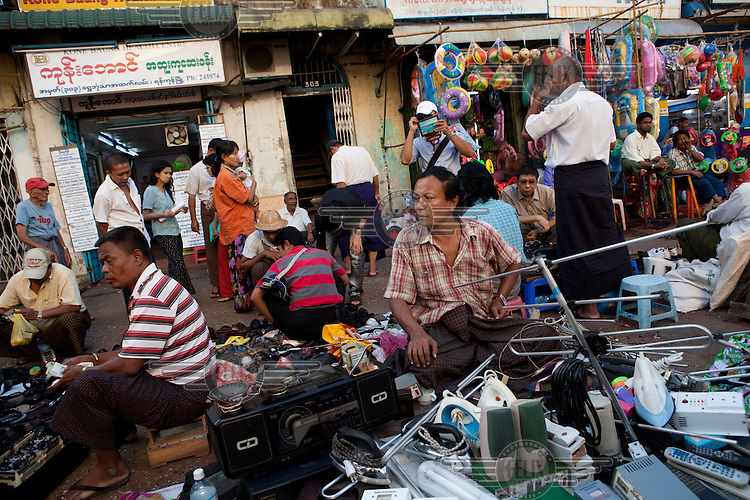 Used electrical equipment is sold at a market in Yangon.
