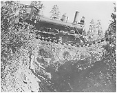 RGS 4-6-0 #25 suspended by rails above Starvation Creek at MP 137.3 after Bridge 138-A washout.<br /> RGS  Starvation Creek, CO  8/14/1909