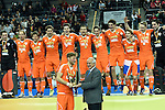 Leipzig, Germany, February 08: Robert Tigges #10 of The Netherlands receives the FIH Indoor Hockey Men World Cup Trophy by Leandro Negre during the FIH Indoor Hockey Men World Cup on February 8, 2015 at the Arena Leipzig in Leipzig, Germany. (Photo by Dirk Markgraf / www.265-images.com) *** Local caption ***