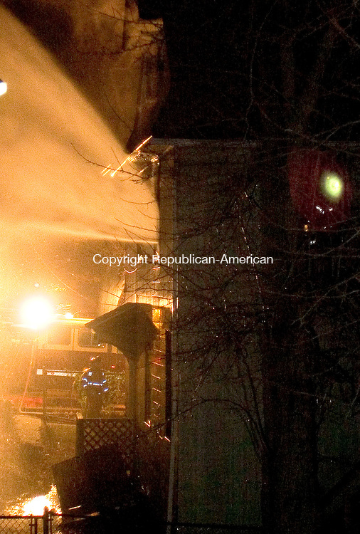 WATERBURY, CT - 05 DECEMBER 2007 - 120507JW01.jpg --Waterbury firefighters work a structure fire late Wednesday evening. Jonathan Wilcox Republican-American