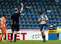 Luke O'Nien of Wycombe Wanderers receives a caution from Referee Christopher Sarginson during the Sky Bet League 2 match between Wycombe Wanderers and Blackpool at Adams Park, High Wycombe, England on the 11th March 2017. Photo by Liam McAvoy.