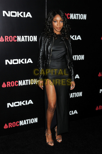 Wynter Gordon.Roc Nation Pre-Grammy Brunch held at Soho House, West Hollywood, California, USA, 11th February 2012..full length black slit split dress  leather jacket  strappy sandals .CAP/ADM/BP.©Byron Purvis/AdMedia/Capital Pictures.