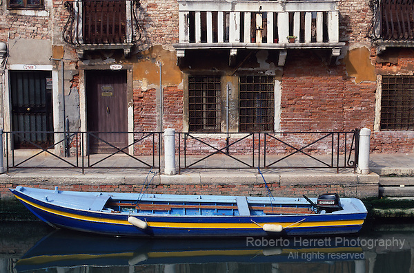 Boat and crumbling buildings, Venice Italy
