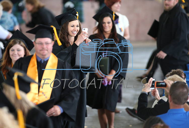 Shelby Price takes a photo after the Western Nevada College commencement at the Pony Express Pavilion, in Carson City, Nev., on Monday, May 19, 2014. <br /> Photo by Cathleen Allison/Nevada Photo Source