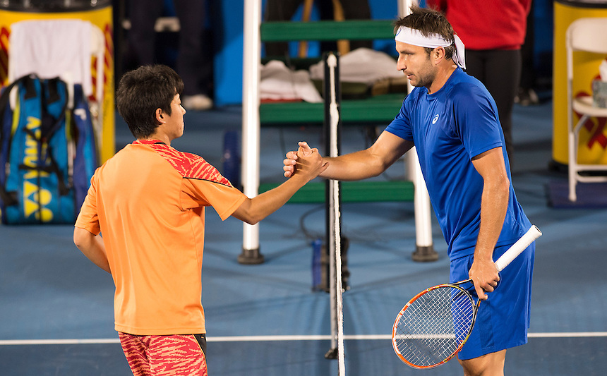 Delray Beach, FL - February 19: Yoshito Nishioka(JPN) shakes hands with Marinko Matosevic(AUS) after defeating him 61 63 at the 2015 Delray Beach Open by The Venetian Las Vegas. Photographer Andrew Patron<br /> <br /> Tennis - 2015 ATP World Tour 250 - The Delray Beach Open by The Venetian Las Vegas - Delray Beach, U.S.A - Day 4 - Thursday 19 February 2015<br /> <br /> &copy; CameraSport - 43 Linden Ave. Countesthorpe. Leicester. England. LE8 5PG - Tel: +44 (0) 116 277 4147 - admin@camerasport.com - www.camerasport.com
