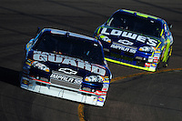 Apr 11, 2008; Avondale, AZ, USA; NASCAR Sprint Cup Series driver Dale Earnhardt Jr leads teammate Jimmie Johnson during practice for the Subway Fresh Fit 500 at Phoenix International Raceway. Mandatory Credit: Mark J. Rebilas-