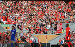 Liverpool fans watch in the sunshine during the Premier League match at Anfield Stadium, Liverpool. Picture date: September 10th, 2016. Pic Simon Bellis/Sportimage