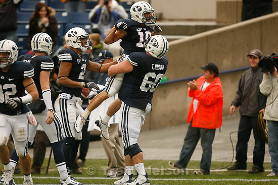 Trent Nelson  |  The Salt Lake Tribune.BYU running back JJ Di Luigi (10) celebrates his first quarter touchdown in the arms of teammate BYU offensive lineman Terence Brown (60). BYU vs. Wyoming, college football Saturday, October 23, 2010 at LaVell Edwards Stadium in Provo.