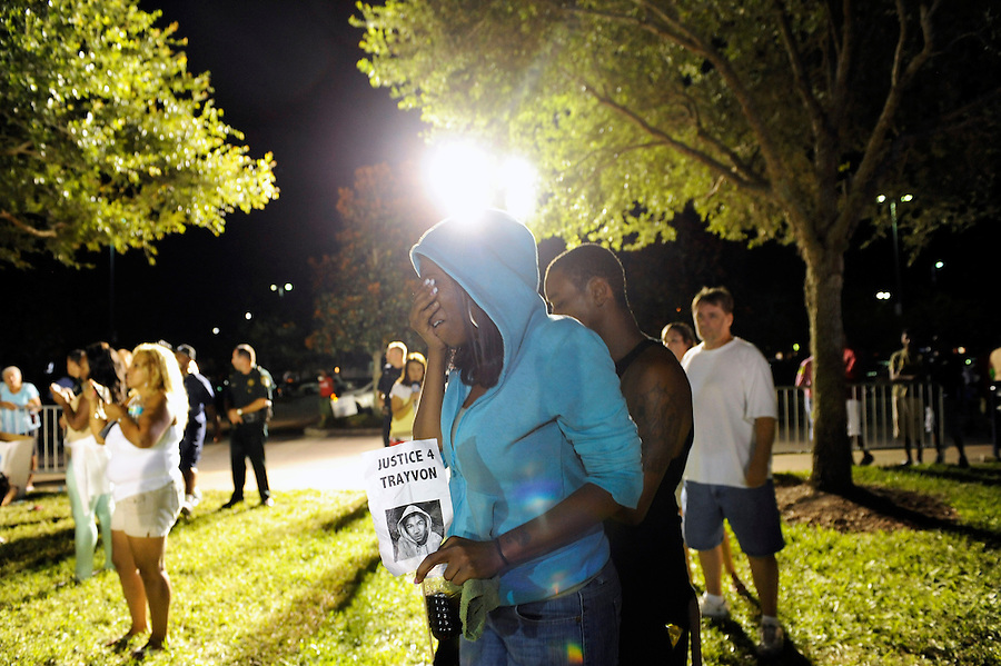 Demonstrators react to the not guilt verdict in the trial of George Zimmerman at the Seminole County Criminal Justice Center in Sanford, Florida, USA, 13 July 2013. Zimmerman, a former volunteer neighborhood watch captain, had been charged with second-degree murder in the 26 February 2012 shooting death of 17 year-old Trayvon Martin in Sanford, Florida.