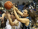 Reed's Makaela Moore and Foothill's Kimmie Sandusky wrestle for a loose ball during a semi-final game in the NIAA 4A State Basketball Championships between Reed and Foothill high schools at Lawlor Events Center in Reno, Nev, on Thursday, Feb. 23, 2012. .Photo by Cathleen Allison