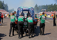 Aug. 3, 2014; Kent, WA, USA; Crew members push NHRA funny car driver John Force to the starting line during the Northwest Nationals at Pacific Raceways. Mandatory Credit: Mark J. Rebilas-USA TODAY Sports