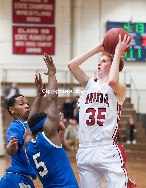 WOODBURY,  CT-122816JS10--Pomperaug's Joshua McGettigan  (35) puts up a shot over Bristol Eastern's  Rod Jenkins (5) and Justin Blake (23) during the Nonnewaug Holiday Tournament held Wednesday at Nonnewaug High School in Woodbury. <br /> Jim Shannon Republican-American