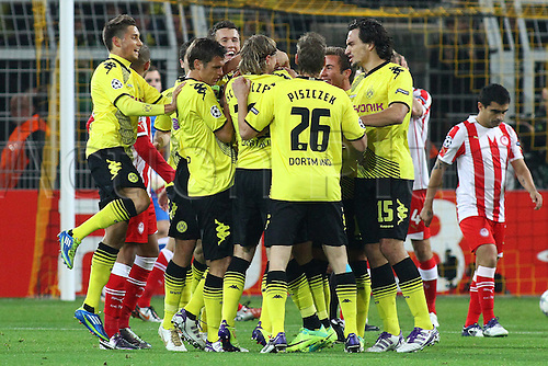 01.10.2011 Dortmund Germany.  Dortmund's Kevin Grossreutz (hidden) celebrates with his teammates after scoring the opening goal during the UEFA Champions League group F soccer match between Borussia Dortmund and Olympiacos Piraeus at the Signal-Iduna-Park stadium in Dortmund, Germany. Mandatory credit: ActionPlus