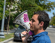 August 12, 2011 (Washington, DC)  Sirwan Kajjo, a political refugee living in the United States, takes to the bull horn as members of the group Code Pink protested in front of the Syrian Embassy in Washington on August 12, 2011.  The group was protesting what they consider Syria's human rights violations against its own people.  (Photo: Media Images International)