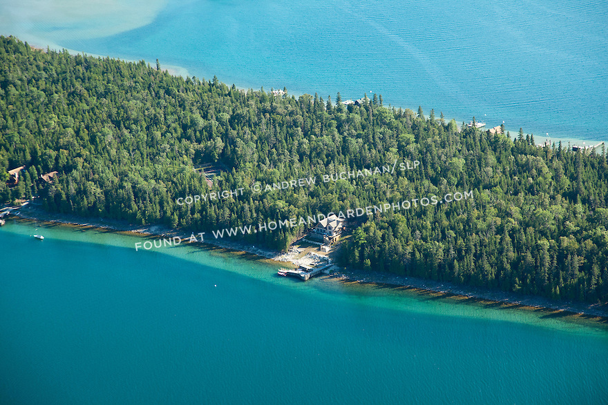 homes and boathouses on Coryell Island shoreline, Les Cheneaux area of Lake Huron near Cedarville, MI