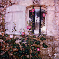 Oppede hollyhocks brighten the view from inside and outside the home. After being abandoned in the 17th Oppede has gained new life.<br />