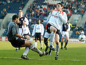 19/03/2005         Copyright Pic : James Stewart.File Name : jspa16_raith_v_falkirk.RAITH KEEPER DAVID BERTHELOT CLEARS FROM DAYRLL DUFFYL...Payments to :.James Stewart Photo Agency 19 Carronlea Drive, Falkirk. FK2 8DN      Vat Reg No. 607 6932 25.Office     : +44 (0)1324 570906     .Mobile   : +44 (0)7721 416997.Fax         : +44 (0)1324 570906.E-mail  :  jim@jspa.co.uk.If you require further information then contact Jim Stewart on any of the numbers above.........A