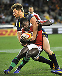AUSTRALIA, Canberra : Christian Wade of the British and Irish Lions gets caught by Clyde Rathbone during the tour match in Canberra on June 18, 2013. The Brumbies won 14-12.  IMAGE STRICTLY RESTRICTED TO EDITORIAL USE - STRICTLY NO COMMERCIAL USE AFP PHOTO / Mark GRAHAM