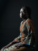 Mary Kuanen at home in Denver, Colorado, Friday, October 21, 2016. Williams a refugee from Sudan moved to Denver 11 years ago with her husband and children. Five years ago her husband was murdered in a mistaken identity gang shooting. <br /> <br /> Photo by Matt Nager