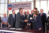 United States President George W. Bush signs the Aviation security bill at Ronald Reagan Washington National Airport in Washington, DC on November 19, 2001.  Bush is shaking hands with US Representative Connie Morella (Republican of Maryland)<br /> Credit: Ron Sachs / CNP