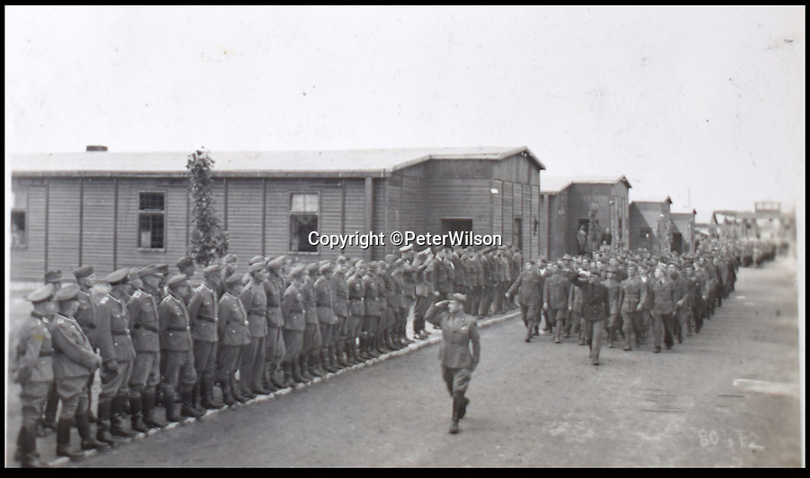 BNPS.co.uk (01202 558833)<br /> Pic: PeterWilson/BNPS<br /> <br /> A review of prisoners by a German commandant.<br /> <br /> A fascinating photo album has to come to light to reveal what went on inside a German POW camp - including stage shows in drag.<br /> <br /> The Stalag Luft IV B album was compiled by British prisoner David Courtney, of 102 Squadron, whose Halifax was shot down near Berlin on January 20, 1944.<br /> <br /> One of the photos shows the funeral of a British soldier who was assassinated by the German guards, although they have taken part in the ceremony by lifting their guns above the coffin.<br /> <br /> Another shows a theatre performance put on by inmates where the performers were dressed as women to keep up morale.
