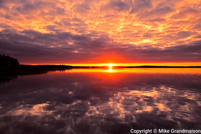 Clouds refelected in Namekus Lake at sunrise<br /> Prince Albert National Park<br /> Saskatchewan<br /> Canada