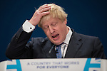 © Joel Goodman - 07973 332324 . 02/10/2016 . Birmingham , UK . Foreign Secretary BORIS JOHNSON speaks to the conference during the first day of the Conservative Party Conference at the International Convention Centre in Birmingham . Photo credit : Joel Goodman