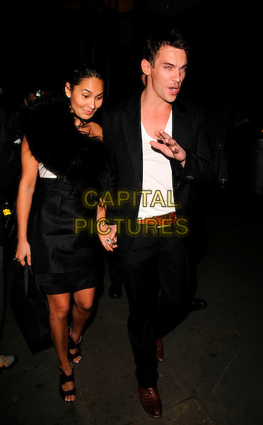 "REENA HAMMER & JONATHAN RHYS MEYERS .Attends ""Not Another Burns Night"" Charity Dinner in aid of Clic Sargent Appeal held at the St Martins Lane Hotel, London, England, March 3rd 2008 full length black dress skirt holding hands white top t-shirt brown belt shoes walking hand.CAP/CAN.?Can Nguyen/Capital Pictures"