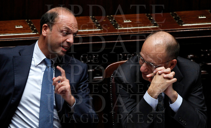Il Ministro dell'Interno e Vicepresidente del Consiglio Angelino Alfano parla al Presidente del Consiglio Enrico Letta, a destra, prima del voto di fiducia sul governo, alla Camera dei Deputati, Roma, 2 ottobre 2013.<br /> Italian Interior Minister and Deputy Premier Angelino Alfano talks to Premier Enrico Letta, right, prior to a confidence vote to the government at the Lower Chamber, Rome, 2 October 2013.<br /> UPDATE IMAGES PRESS/Isabella Bonotto