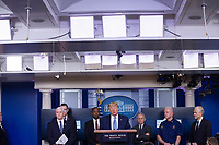 United States President Donald J. Trump, center, makes remarks on the Coronavirus crisis in the Brady Press Briefing Room of the White House in Washington, DC on Saturday, March 21, 2020.  <br /> Credit: Stefani Reynolds / Pool via CNP/AdMedia
