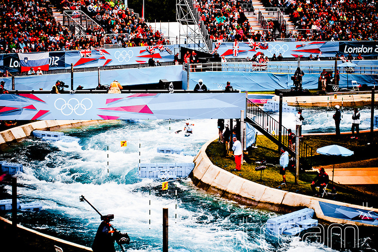 Canoe slalom, and spectators in the stand, at the Lee Valley White Water Park during the 2012 London Olympics