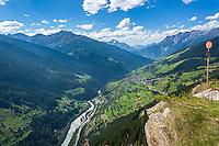 Austria, Tyrol, Inn Valley: view from Pillerhoehe Passroad towards village Fliess with parish church St Barbara | Oesterreich, Tirol, Inntal: Blick von der Pillerhoehe auf den den Ort Fliess mit der Neuen Pfarrkirche St. Barbara