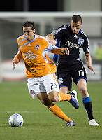 28 March 2009: Geoff Cameron of Dynamo dribbles the ball away from Cam Weaver of Earthquakes during the game at Buck Shaw Stadium in Santa Clara, California.  San Jose Earthquakes defeated Houston Dynamo, 3-2.