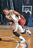 Florida International University guard Phil Taylor (11) plays against Florida Memorial University in an exhibition game.  FIU won the game 86-69 on November 9, 2011 at Miami, Florida. .