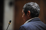 witness Santiago Perez pauses before his testimony in the Supreme during the second day of trial of former Guatemalan dictator, Efrain Rios Montt in the Supreme Court of Justice Guatemala CIty March 20, 2013.