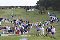 The crowd leaving the1st tee following Jimenez, Luiten and Manassero during Round 2 of the KLM Open at Kennemer Golf &amp; Country Club on Friday 12th September 2014.<br /> Picture:  Thos Caffrey / www.golffile