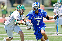 April 30, 2011:  Duke Blue Devils midfielder Jake Tripucka (7) runs the ball down the field while being guarded by Jacksonville Dolphins defender Garrett Swaim (14) during lacrosse action between the Duke Blue Devils and Jacksonville Dolphins at D. B. Milne Field in Jacksonville, Florida.  Duke defeated Jacksonville 10-6.