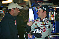 Jimmie Johnson, right, and crew chief Chad Knaus at the Carolina Dodge Dealers 400 NASCAR WInston Cup race at Darlington Raceway, Darlington, SC, March 16, 2003.  (Photo by Brian Cleary/www.bcpix.com)
