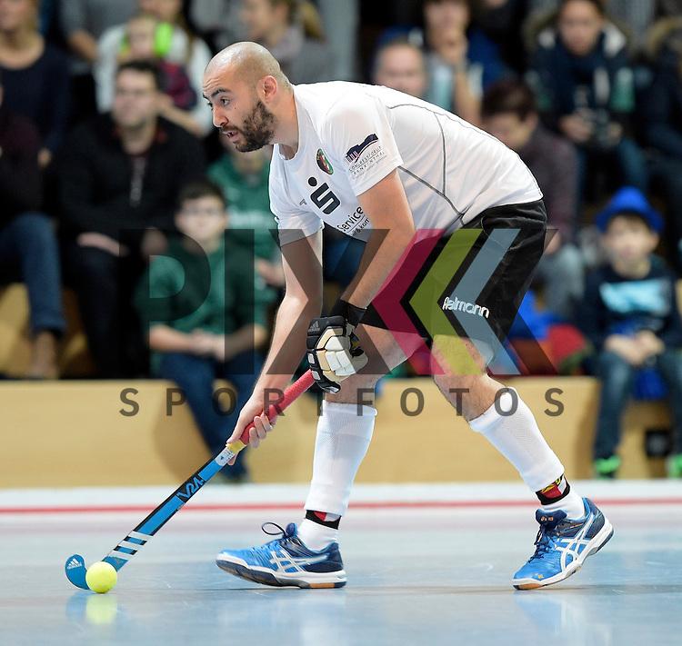 GER - Mannheim, Germany, November 28: During the 1. Bundesliga Sued Herren indoor hockey match between Mannheimer HC (red) and TG Frankenthal (white) on November 28, 2015 at Irma-Roechling-Halle in Mannheim, Germany. Final score 7-7 (HT 3-3).  Can Yurtseven #29 of TG Frankenthal<br /> <br /> Foto &copy; PIX-Sportfotos *** Foto ist honorarpflichtig! *** Auf Anfrage in hoeherer Qualitaet/Aufloesung. Belegexemplar erbeten. Veroeffentlichung ausschliesslich fuer journalistisch-publizistische Zwecke. For editorial use only.