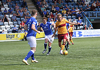 Christian Ilić being pressured by Andy McCarthy in the SPFL Betfred League Cup group match between Queen of the South and Motherwell at Palmerston Park, Dumfries on 13.7.19.