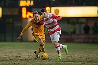 Tommy Rowe of Doncaster Rovers gets past Ryan Bird of Newport County during the Sky Bet League 2 match between Newport County and Doncaster Rovers at Rodney Parade, Newport, Wales on 10 February 2017. Photo by Mark  Hawkins / PRiME Media Images.