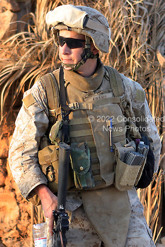 U.S. Marine Corps Lance Cpl. John J. Adams, from India Company, 3rd Battalion, 3rd Marine Regiment, conducts a patrol in Haditha, Iraq, Aug. 8, 2006. (U.S. Marine Corps photo by Cpl. Brian M. Henner) (Released)