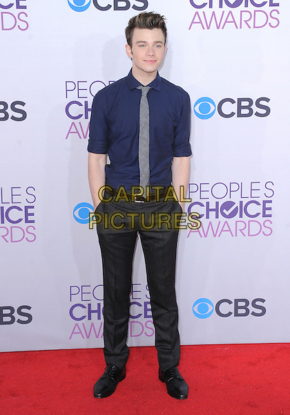 Chris Colfer.The 2013 People's Choice Awards held at Nokia Live in Los Angeles, California 9th January 2013                                                                   .full length grey gray trousers hands in pockets blue shirt grey gray tie .CAP/DVS.©DVS/Capital Pictures.