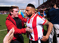 Lincoln City's Nathan Arnold is mobbed at the final whistle<br /> <br /> Photographer Andrew Vaughan/CameraSport<br /> <br /> Vanarama National League - Lincoln City v Macclesfield Town - Saturday 22nd April 2017 - Sincil Bank - Lincoln<br /> <br /> World Copyright &copy; 2017 CameraSport. All rights reserved. 43 Linden Ave. Countesthorpe. Leicester. England. LE8 5PG - Tel: +44 (0) 116 277 4147 - admin@camerasport.com - www.camerasport.com